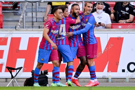 Stock Image of Barcelona's Memphis Depay (2-R) celebrates with his teammates after scoring the 1-0 lead during the pre-season friendly test soccer match between VfB Stuttgart and FC Barcelona in Stuttgart, Germany, 31 July 2021.