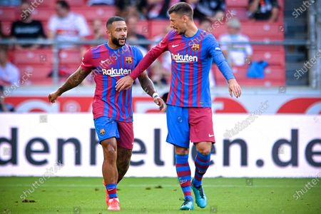 Barcelona's Memphis Depay (L) celebrates with his teammates after scoring the 1-0 lead during the pre-season friendly test soccer match between VfB Stuttgart and FC Barcelona in Stuttgart, Germany, 31 July 2021.