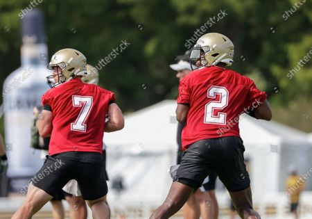 New Orleans Saints quarterback Jameis Winston (2) and quarterback Taysom Hill (7) drop back in passing drills during NFL football training camp in Metairie