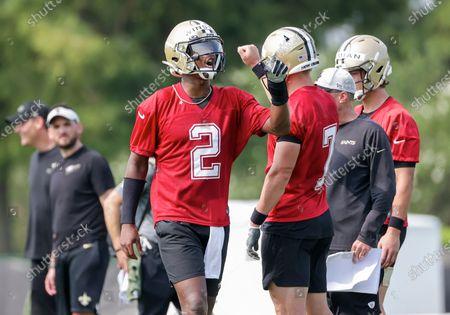 New Orleans Saints quarterback Jameis Winston (2) reacts with quarterback Taysom Hill (7) during NFL football training camp in Metairie