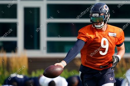 Stock Image of Chicago Bears quarterback Nick Foles works on the field during NFL football practice in Lake Forest, Ill