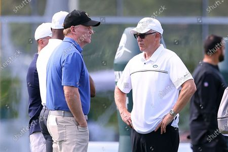 Commissioner Roger Goodell, left, talks with New York Jets Chairman Robert Johnson during practice at the team's NFL football training facility, in Florham Park, N.J