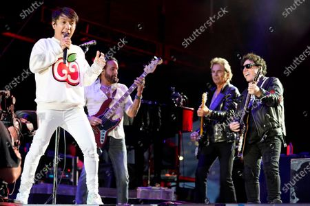 Arnel Pineda, from left, Marco Mendoza, Jonathan Cain, and Neal Schon of the band Journey perform on day three of the Lollapalooza music festival, at Grant Park in Chicago