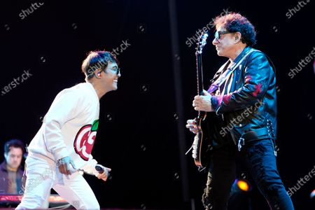 Arnel Pineda, left, and Neal Schon of the band Journey perform on day three of the Lollapalooza music festival, at Grant Park in Chicago