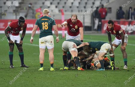 (L to R) Maro Itoje, Alun Wyn Jones and Courtney Lawes - British & Irish Lions, wait on Faf de Klerk - South Africa scrum half digging the ball out for a box kick.