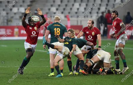 Maro Itoje - British & Irish Lions lock attempts to charge down a kick by Faf de Klerk - South Africa as Alun Wyn Jones and Courtney Lawes look on.