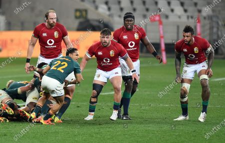 (L to R) Alun Wyn Jones, Rory Sutherland, Maro Itoje and Courtney Lawes - British & Irish Lions players look on as Herschel Jantjies - South Africa replacement winds up a pass.