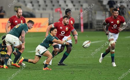 (L to R) Alun Wyn Jones, Rory Sutherland, Maro Itoje and Courtney Lawes - British & Irish Lions players look on as Herschel Jantjies - South Africa replacement passes down the backline.