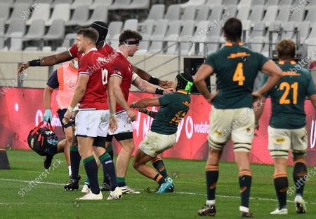 Tom Curry and Maro Itoje confront Springbok winger Cheslin Kolbe after he dangerously 'took out' Lions scrum half Conor Murray in the air.