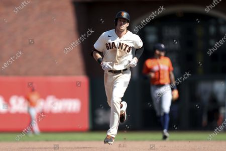 Stock Picture of San Francisco Giants' Mike Yastrzemski runs the bases after hitting a solo home run against the Houston Astros during the eighth inning of a baseball game in San Francisco