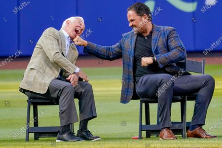 Former New York Mets catcher Mike Piazza, right, and former Mets manager Bobby Valentine joke around during a Mets Hall of Fame induction ceremony, in New York