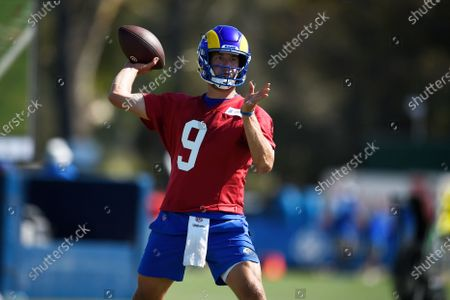 Los Angeles Rams quarterback Matthew Stafford throws a pass during NFL football training camp practice in Irvine, Calif