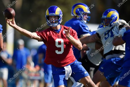 Los Angeles Rams quarterback Matthew Stafford throws a pass during an NFL football training camp practice in Irvine, Calif