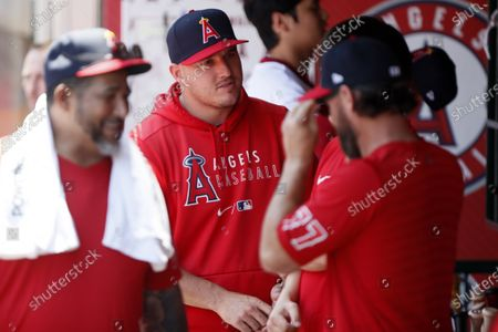 Los Angeles Angels' Mike Trout, second from left, talks with a teammate before a baseball game against the Oakland Athletics in Anaheim, Calif
