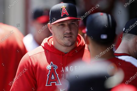 Los Angeles Angels' Mike Trout talks with a teammate before a baseball game against the Oakland Athletics in Anaheim, Calif