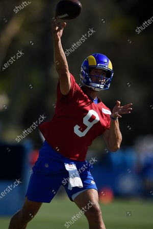 Stock Photo of Los Angeles Rams quarterback Matthew Stafford runs drills during an NFL football training camp practice in Irvine, Calif