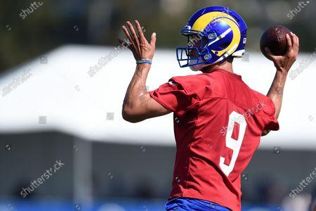 Los Angeles Rams quarterback Matthew Stafford runs drills during an NFL football training camp practice in Irvine, Calif