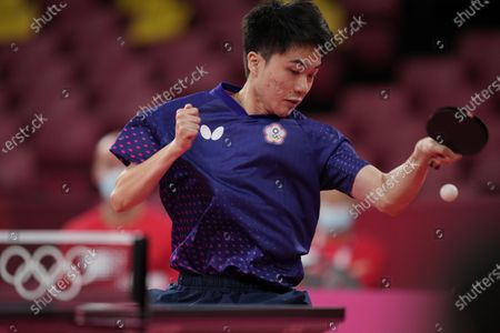 Taiwan's Lin Yun-ju competes during the table tennis men's team round of 16 against Croatia's Pucar Tomislav at the 2020 Summer Olympics, in Tokyo, Japan