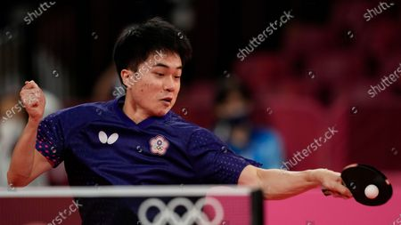 Lin Yun Ju of Taiwan returns a shot during table tennis men's team round of 16 match against Tomislav Pucar of Croatia at the 2020 Summer Olympics, in Tokyo, Japan