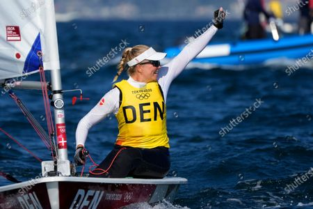 Denmark's Anne-Marie Rindom celebrates after placing first in the women's laser radial medal race at the 2020 Summer Olympics, in Fujisawa, Japan