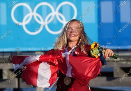 Gold medallist Anne-Marie Rindom of Denmark poses after the Women's One Person Dinghy Laser Radial Medal Race during the Sailing events of the Tokyo 2020 Olympic Games in Enoshima, Japan, 01 August 2021.