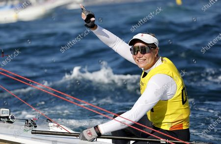 Anne-Marie Rindom of Denmark celebrates winning the Women's One Person Dinghy Laser during the Sailing events of the Tokyo 2020 Olympic Games in Enoshima, Japan, 01 August 2021.