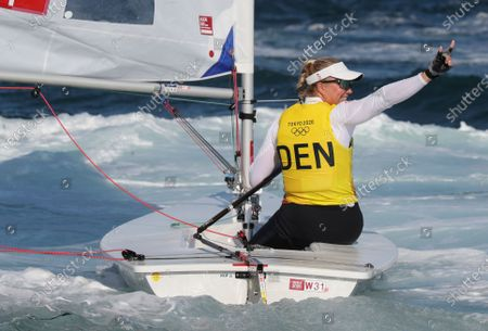 Winner Anne-Marie Rindom of Denmark celebrates after the medal race in the Women's One Person Dinghy Laser during the Sailing events of the Tokyo 2020 Olympic Games in Enoshima, Japan, 01 August 2021.