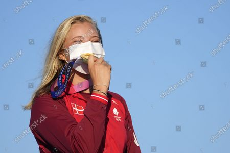 First placed Denmark's Anne-Marie Rindom holds the gold medal at the end of the women's laser medal race at the 2020 Summer Olympics, in Fujisawa, Japan