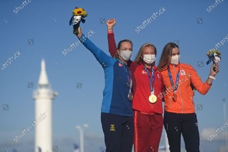 (210801) - KANAGAWA, Aug 1, 2021 (Xinhua) - Gold medalist Anne-Marie Rindom (C) of Denmark, silver medalist Josefin Olsson (L) of Sweden and bronze medalist Marit Bouwmeester of the Netherlands pose for photos during the awarding ceremony for the women's one person dinghy laser radial of the sailing competition at the Tokyo 2020 Olympic Games in Kanagawa, Japan, Aug 1, 2021.