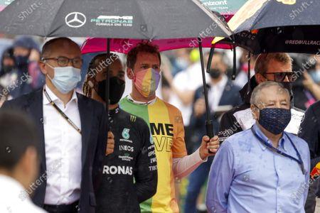 Stefano Domenicali, CEO, Formula 1, Sir Lewis Hamilton, Mercedes, and Sebastian Vettel, Aston Martin, Jean Todt, President, FIA, on the grid during the 2021 Formula One Hungarian Grand Prix