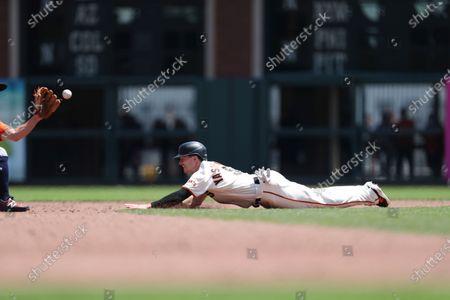 San Francisco Giants' Mike Yastrzemski runs the bases against the Houston Astros during a baseball game in San Francisco