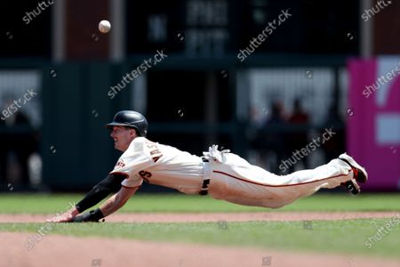 Stock Photo of San Francisco Giants' Mike Yastrzemski runs the bases against the Houston Astros during a baseball game in San Francisco