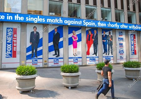 Pictured in promotional posters outside Fox News studios at News Corporation headquarters in New York, are hosts Tucker Carlson, Sean Hannity, Laura Ingraham, Maria Bartiromo, Stuart Varney, Neil Cavuto and Charles Payne