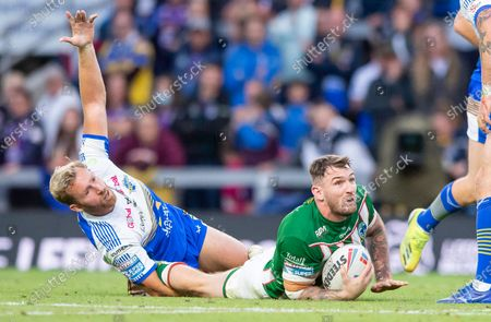 Leeds's Matt Prior protests after a tackle on Warrington's Daryl Clark.