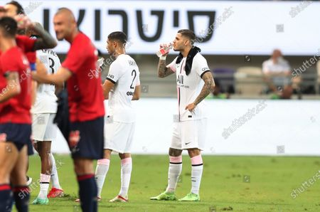 PSG's Mauro Icardi, right, drinks during a water break during the French Super Cup final soccer match between Lille and Paris Saint-Germain at Bloomfield Stadium in Tel Aviv, Israel