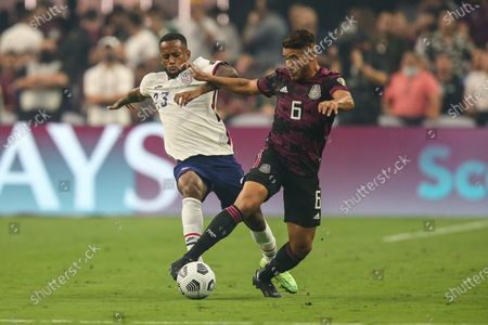 United States midfielder Kellyn Acosta (23) and Mexico midfielder Jonathan dos Santos (6) battle for the ball during the first half of the CONCACAF Gold Cup Final featuring the United States and Mexico at Allegiant Stadium in Las Vegas, NV. At halftime United States and Mexico are tied 0-0