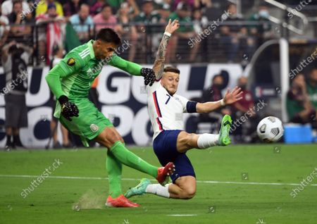 United States forward Paul Arriola (7) attempts to block a kick by Mexico goalkeeper Alfredo Talavera during the first half of the CONCACAF Gold Cup final soccer match, in Las Vegas