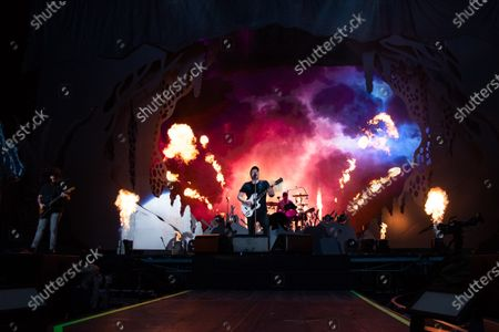 Joe Trohman, Andy Hurley, Patrick Stump, and Pete Wentz of Fall Out Boy perform