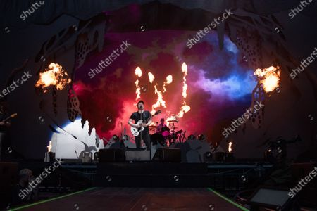 Stock Photo of Joe Trohman, Andy Hurley, Patrick Stump, and Pete Wentz of Fall Out Boy perform
