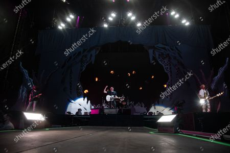 Joe Trohman, Patrick Stump, and Pete Wentz of Fall Out Boy perform