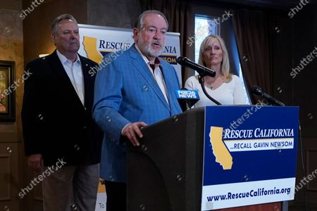 Former Arkansas Gov. Mike Huckabee, a Republican, speaks in support of the recall of Calif., Gov. Gavin Newsom Calif., . Huckabee, flanked by former California Secretary of State Bill Jones, a Republican, and Anne Dunsmore, campaign manager of the pro-recall group Rescue California, attended a fund raising breakfast for the recall campaign. While Democratic registration almost doubles that of Republicans in the state, Democratic Party leaders fear Republicans appear more eager to vote in the Sept. 14 election