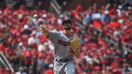 Stock Picture of Minnesota Twins relief pitcher John Gant attempts to pick off St. Louis Cardinals' Yadier Molina during the fifth inning of a baseball game, in St. Louis