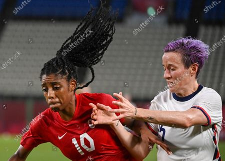 (210802) - IBARAKI, Aug 2, 2021 (Xinhua) - Megan Rapinoe (R) of the United States lives with Ashley Lawrence of Canada during the women's football semifinal match between the United States and Canada at Tokyo 2020 Olympic Games in Ibaraki, Japan, Aug. 2, 2021.