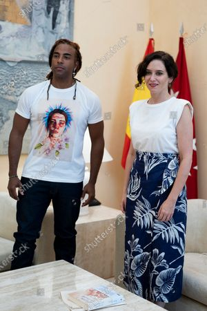 President of the Community of Madrid, Isabel Diaz Ayuso and Cuban artist Yotuel Romero seen during a meeting at the Real Casa de Correos in Madrid. Yotuel is the composer of 'Patria y Vida', a song whose title has become the slogan of the protests of the Cuban people against the ruling regime.