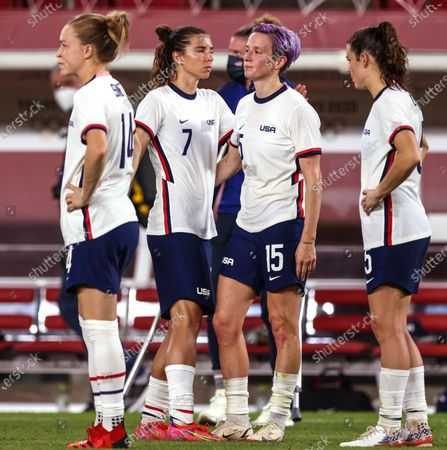 Tokyo, Japan, Monday, August 2, 2021 - Dejected teammates console each other after losing 0-1 to Team Canada in the Women's Football Semifinal at Ibaraki Kashima Stadium. Left to right are Emily Sonnett, Tobin Heath, Megan Rapinoe and Kelley O'Hara. (Robert Gauthier/Los Angeles Times)