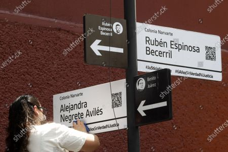 Gabriela Mejía, daughter of Alejandra Negrete, names a street in her honor. Murdered  victims, activist Nadia Vera, domestic worker Alejandra Negrete, beauty student Yesenia Quiroz, model Mile Martin and photojournalist Ruben Espinosa, that they were killed with firearm shots,  inside of  department of the 1909 building, on Luz Savinon street in  Narvarte neighborhood 6 years ago. Relatives take part during a protest to demand Justice for the  multihomicide. On July 31, 2021 in Mexico City, Mexico.