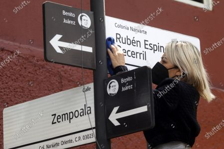 Patricia Espinosa Becerril, sister of  Ruben Espinosa Becerril, names a street in his honor. Murdered  victims, activist Nadia Vera, domestic worker Alejandra Negrete, beauty student Yesenia Quiroz, model Mile Martin and photojournalist Ruben Espinosa, that they were killed with firearm shots,  inside of  department of the 1909 building, on Luz Savinon street in  Narvarte neighborhood 6 years ago. Relatives take part during a protest to demand Justice for the  multihomicide. On July 31, 2021 in Mexico City, Mexico.