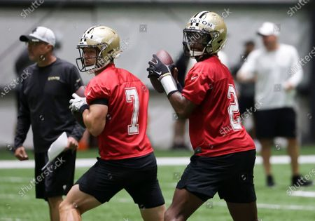 Stock Image of New Orleans Saints quarterback Jameis Winston (2) and quarterback Taysom Hill (7) throw during NFL football training camp in Metairie