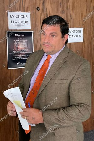 """Attorney Michael Cassone, who files eviction notices on behalf of landlords and property managers, stands outside Franklin County evictions court, in Columbus, Ohio. Housing advocates fear the end of the Centers for Disease Control and Prevention moratorium on evictions Saturday July 31, could eventually result in millions of people being evicted. Cassone said the full impact is hard to predict because there's no much unspent rental assistance money still available. """"Landlords want money,"""" Cassone said. """"They don't want empty apartments"""