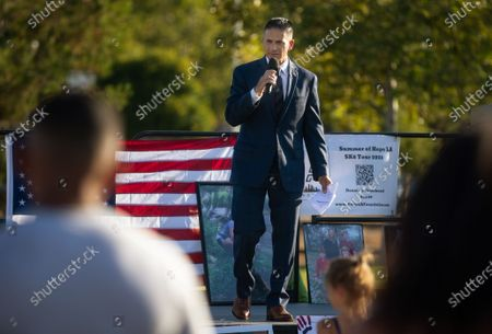 Jon Hatami, head of the DA's child abuse speaks to the crowd gathered and leads the call for the recall of George Gascon on Thursday, July 29, 2021 in Santa Clarita, CA.(Jason Armond / Los Angeles Times)